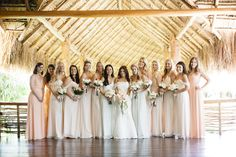 The bridesmaids wore mismatching dresses in ivory and peach hues. #BridesmaidDresses #BeachWedding Photography: Stephen Karlisch. Read More: http://www.insideweddings.com/weddings/elegant-beachside-destination-wedding-in-playa-del-carmen-mexico/663/