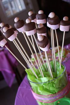 Strawberry Marshmallows dipped in Chocolate with malt ball on top.
