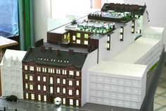 "The architectural model of the residential complex ""New Holland"". On the photo: the illuminated courtyard. Макет жилого комплекса ""Новая Голландия"". На фото: подсвеченный двор."