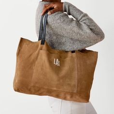 The soft, relaxed feel of suede is balanced with unmistakable craftsmanship to create a durable, wearable, everyday tote that already feels like your go-to carryall. The high-quality suede is complemented by double-sided leather straps, magnetic s… Cheap Handbags, Black Handbags, Handbags Michael Kors, Louis Vuitton Handbags, Purses And Handbags, Luxury Handbags, Designer Handbags, Latest Handbags, Popular Handbags