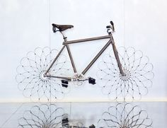 "For W Hotels' ""WOW Bikes,"" Ron Arad designs a bespoke bicycle that reimagines the wheel using nothing but curved sprung steel. And anyone who stays at the hotel can ride it"