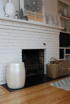 Painted fireplace hearth tile. Remove bricks and put down slate to be flush with floor.