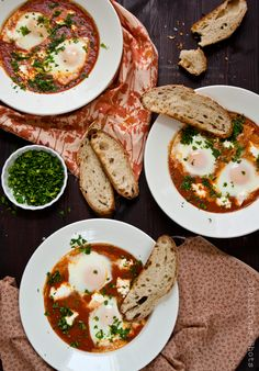 Ingredients:  3 tablespoons of olive oil 1/4 cup of onions, chopped 4 garlic cloves, crushed 2 15oz cans whole peeled tomatoes 6 eggs 1 tsp cumin 1/2 tsp paprika 1/2 cup water salt and pepper to taste feta cheese chopped parsley