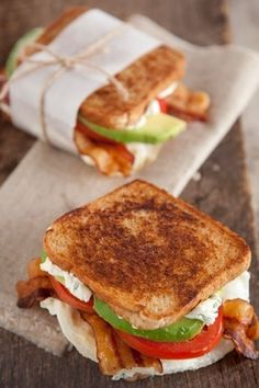 Fried Egg, Avocado, Bacon, Cream Cheese, Green Onion, & Tomato Sandwich. Brunch!.. I'll use turkey bacon