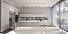 Great Minimalist Kitchen behind White Sofa SL House by Domb Architects. Wood Interior Design, Beautiful Interior Design, Modern Interior, Interior Architecture, Style At Home, Cheap Kitchen Makeover, Kitchen Wall Colors, Contemporary Kitchen Design, Best Kitchen Designs