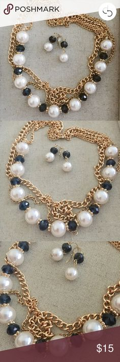 DRESS BARN Fashion Statement Necklace/Earrings Set NWOT! Never worn! Four graduated strands consisting of faux pearls, gold-tone loops, & blue faceted beads create this classic/timeless look! Adjustable length extenders allow for different sizing options, as desired. Lobster claw clasp. French wire loop earrings with stoppers. Selling as a set only. Bundle with other items for discounted savings! Dress Barn Jewelry Necklaces