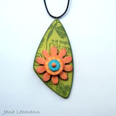 """""""Garden"""" - polymer clay, colorbox chalks - stamped pendant with rotatable flower"""