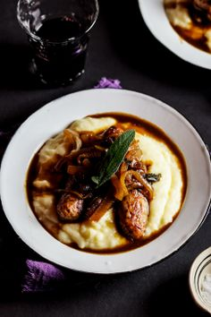 Sage-roasted pork sausages on mash with the ultimate onion gravy #recipe