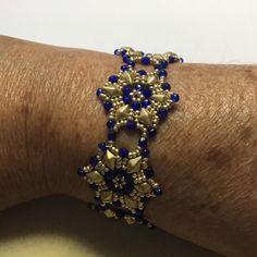 Gorgeous Starflower Bracelet beaded up by Alice Byrne Hamdi in gold and cobalt.