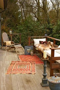 Donna-Maria McCubbin.My hubby would love this extended raised deck surrounded by forest with day beds to lounge and converse on.