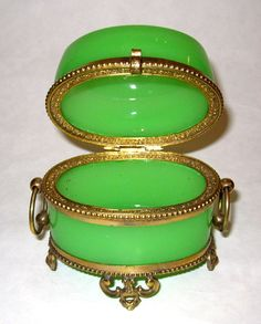 A oval French 19th Century green opaline antique glass casket with pretty ormolu mounts. See extra photos for internal intricate dore bronze mounts.