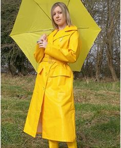 .Well dressed in her yellow mac, boots and matching brolly to brighten up a rainy day.