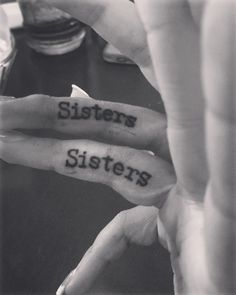 Sister tattoo on finger