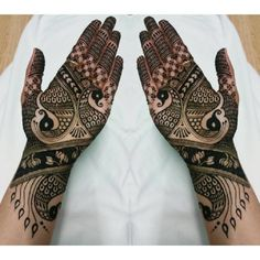 simple-mehendi-design-with-peacocks-front-hand