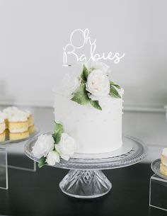 White fondant cake with sugar flowers and silver laser cut cake topper // Two Peas in a Pod: Sonya Davison's Twin Gender Reveal