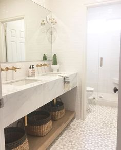 A shot from our #arbolesproject girls bathroom! Custom marble vanity and marble mosaic tiles by @newravenna. Also this weeks favorites on Beckiowens.com.