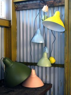 First:     Kitchen Lighting Idea for over the Island. These industrial IKEA light fixtures were spray painted for a little extra punch. If you grow tired of the color, just repaint instead of buying a new light.