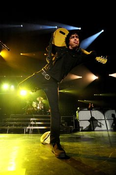 Billie Joe Armstrong- he can stand on one leg, play his guitar behind his back and stick his tongue out all at the same time!!!