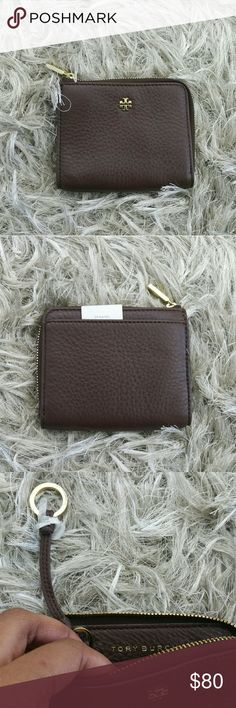 "2017 NWT TORY BURCH MERCER HALF ZIP WALLET TORY BURCH  MERCER HALF ZIP CARD CASE WALLET KEY RING Half-Zip Card Case stores swipe cards, transit passes, IDs - perfect for commuting, meetings and swapping out bags.  Features: Made of  pebbled Leather Approx. 4"" x 3"" Zip Closure Interior key ring. Fabric Lining.  Gold Tone Hardware.  Absolutely Timeless Tory Burch Bags Wallets"