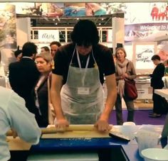 """@Erin B Bender is working hard at our #WeAreinPuglia stand. """"Cartellate"""" Christmas pastries with Josh! #WTM13"""