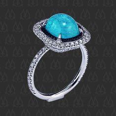 Halo ring, featuring 3.14 carat cabochon blue tourmaline. Brazilian Paraiba Tourmaline Cabochon by Leon Mege www.micropave.com