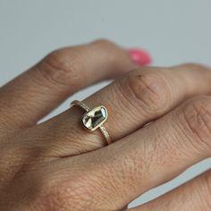 One of a kind free form Diamond slice ring with side White Diamonds.  Product details Main stone Gemstone: Diamond Gemstone car