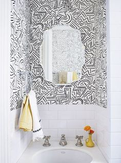 Powder room with black and white wallpaper