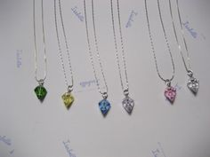 """Tiny Glass """"Diamond"""" Perfume Necklace Pendants can be filled with small beads, perfume, or sand in 6 Colors. $12.50, via Etsy."""