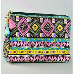 "Aztec Print Makeup Bag clutch Very cute and perfect for your makeup or even your pencils and pens. Perfect size to use a small clutch also. Tassel accent on zipper pull. Approximately 7.5"" x 2.5"" x 5.5"" Justina's Closet Bags Cosmetic Bags & Cases"
