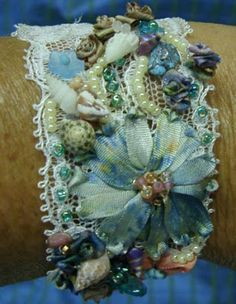 Bracelet collage! This lady has a definite style (which I do love) - but imagine all the possibilities for collage-ing onto one of those big plastic bracelets. Crazy Quilt Gatherings: Bracelets