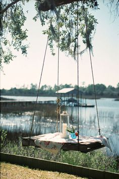 We are loving this outdoor hanging table! #table #hangingtable #dwell