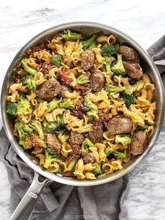 This One Pot Sausage and Sun Dried Tomato Pasta cooks quickly and in one skillet so that no flavor is lost! Make dinner fast, easy, and delicious. BudgetBytes.com Fast Easy Dinner, Fast Dinner Recipes, Fast Dinners, Real Food Recipes, Cooking Recipes, Yummy Food, Italian Sausage Recipes, Sweet Italian Sausage, How To Cook Sausage