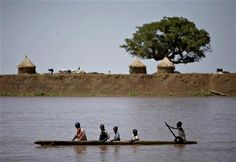People from the Nuer tribe paddle a canoe across a river in the town of Nasir in southeastern Sudan, 2009 African Union, Fishing Boats, Canoe, Paddle, 1, River, Rivers