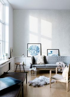 Living room: White walls, but bring in pops of ocean blue in art. That is an IKEA leaf side table.
