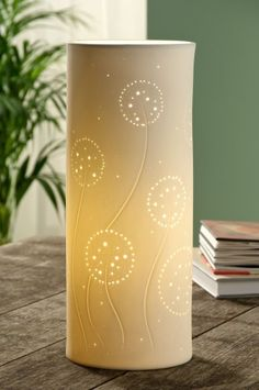 Belleek Living Dandelion Luminaire Lamp  This nature inspired lamp features pierced dandelion clocks on swaying stems. Tumbling seeds radiate light as if experiencing a summer's evening breeze.   The effect is soft mood lighting for a naturally elegant living space. £44.00