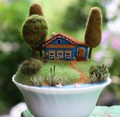 Fairy houses in the technique of dry felting. Interesting crafts