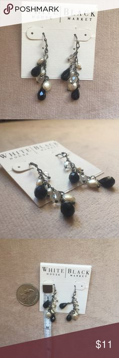 NWT White House Black Market Earrings Faux Pearl These are a brand new pair of dangly earrings from White House Black Market. They are a combination of black, clear and faux pearl beads on a silver toned chain. Plastic backings included to keep these in place.   Earrings dangle just over 1.5 inches long (see photo). They are great for work or for jazzing up an outfit on a night out. Great to give as a gift!  Originally $28 White House Black Market Jewelry Earrings