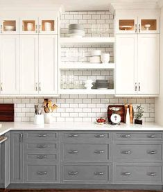 How to style your kitchen with two tone kitchen cabinets! Browse through 13 different two tone kitchen cabinets for the ultimate kitchen cabinet inspiration. For more paint and kitchen decorating ideas go to Domino. Two Tone Kitchen Cabinets, Kitchen Redo, Kitchen And Bath, New Kitchen, Kitchen Dining, White Cabinets, Kitchen White, Kitchen Ideas, Kitchen Inspiration
