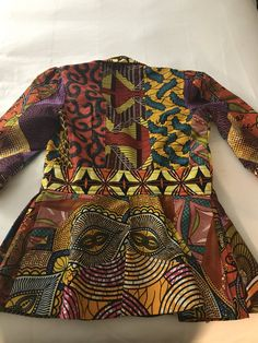 """Wakandan Afro State of Mind on Twitter: """"Y'all. I'm sitting in a restaurant w 2 mentors who were just blessing my soul. A Black couple walks past the table & the brotha stops to say he likes my blazer & that he was """"reading it throughout their whole dinner."""" We look at him like wha..? This is the blazer (by @AnnaTeiko)… https://t.co/zhYnbGel7B"""""""