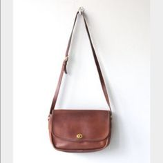 Vintage Coach Brown Leather Cross Body AUTHENTIC vintage brown leather cross body satchel with back pocket, two sections and zipper pocket inside! Coach Bags Crossbody Bags