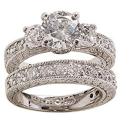 <li>Cubic zirconia bridal-inspired ring set</li><li>Brass jewelry</li><li><a href='http://www.overstock.com/downloads/pdf/2010_RingSizing.pdf'><span class='links'>Click here for ring sizing guide</span></a></li>