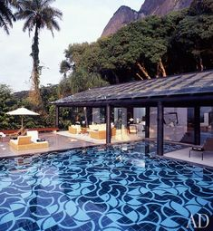 Swimming pool - Luxurious Interiors + Inspiration: black tiles instead of the standard blue ones.