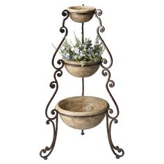 Three-tiered plant stand with scrolling detail.    Product: PlanterConstruction Material: Cast stone and metal