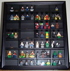 Lego Mini-Fig display case - made from a shot glass display case.  I'm thinking an old type set tray would work.