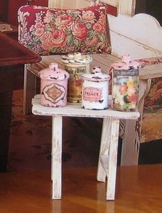 "Miniature canisters for the dollhouse made  from ""A piece of dowel (I found it in the garage), a button and a bead!!"" Very simple way to make vintage containers for the kitchen (e.g. flour) boudoir or bathroom (scented talcums) 