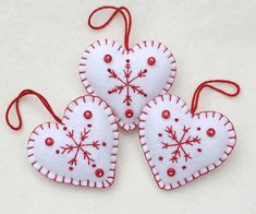 Red and white felt snowflake Christmas ornaments. These handmade felt heart ornaments are embroidered with snowflakes and finished with tiny buttons and a loop Scandi Christmas, Christmas Sewing, Christmas Embroidery, Handmade Christmas Decorations, Felt Decorations, Felt Christmas Ornaments, Felt Crafts, Christmas Crafts, Boutique Scrapbooking