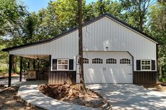 Pole Barn house built on concrete slab with garage and lean-to Pole Barn Prices, Pole Barn Cost, Diy Pole Barn, Building A Pole Barn, Pole Barn Garage, Pole Barn House Plans, Pole Barn Homes, Car Garage, Garage Kits