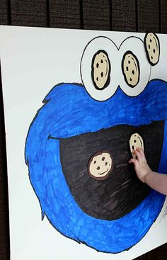 Pin the Cookie on the Monster!  My husband drew cookie monster and I made cookies on my cricut.  The kids were blindfolded and then stuck the cookie.  They preferred the cookies on his eyes.  I was told my cookies should have been bigger since he had a big mouth.  lol  I used scrapbook squares to stick the cookie after being used a couple of times and falling on the ground they weren't very sticky anymore.