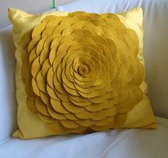 here's the link to how to do it.   http://hellobeautifulblog.blogspot.com/2011/07/felt-flower-cushion-tutorial.html