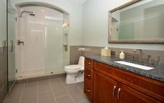 Bathroom Remodel  -Tile Floor  -Granite Countertop  -Mirror Frame  -Frameless Shower Door  -Tile Shower  -Granite Threshold  -Plumbing  -Painting